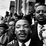March 1965, Selma, Alabama, USA --- Martin Luther King Jr. stands next to Reverend Ralph Abernathy (r) and Reverend Joseph Lowery (l) at a rally held in Selma, Alabama, during marches to Montgomery. --- Image by Flip Schulke/CORBIS Activist Adults African Americans Alabama Americans Blacks Candid Civil rights activists Dallas County Deep South Desegregation Discrimination Group Head and shoulders Human rights Joseph Lowery Males Marches Martin Luther King, Jr. Men Mid-adult Mid-adult man North America People Political and social issues Prominent persons Public demonstration Racism Rally Ralph Abernathy Reformers Segregation Selma Selma-Montgomery Civil Rights Marches, 1965 Social issues Social reformers Southern United States USA
